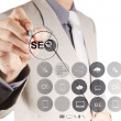 Businessman hand showing search engine optimization SEO — Stock Photo