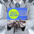 Stock Photo: Business mwith open hand as showing buy now on laptop comp