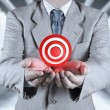Businessman hand shows target symbol as business — Stock Photo #31384623