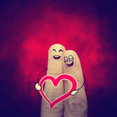 The happy vintage finger couple in love with painted smiley — Stock Photo