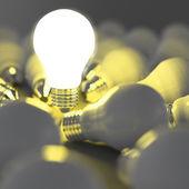 Ampoule debout dehors de l'ampoule à incandescence non éclairée de plus en plus — Photo