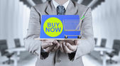 Business man with an open hand as showing buy now on laptop comp — Stock Photo