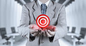 Businessman hand shows target symbol as business — Stock Photo