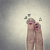 Happy finger couple in love with painted smiley and sing a song — Stockfoto