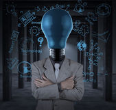 Bulb headed man and business plan concept on wall — Stockfoto