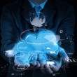 Stock Photo: Businessman working with a Cloud Computing diagram on the new co
