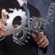 Businessman hand shows gear to success concept — Stock Photo
