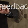 Businessman hand writing Feedback with recycle paper background — Stock Photo