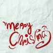 Christmas Card with Santa Claus hand drawn on wrinkled paper — Stock Photo #32169387