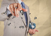 Businessman show social network structure with crumpled recycle — Stock Photo