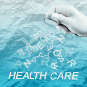 Stethoscope in hand with health care word as medical concept — Stock Photo