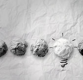 Light bulb crumpled paper — Stock Photo