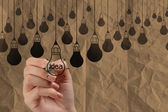 Hand draws light bulb crumpled recycle paper in pencil light bul — Stock Photo