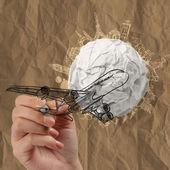 Hand draws airplane crumpled paper and traveling around the worl — Stock Photo