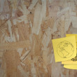Sticky paper note on recycled compressed wood chippings board — Stock Photo