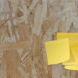 Sticky paper note on recycled compressed wood chippings board — Stock Photo #33310901