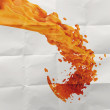 3D paint orange color splash on crumpled paper background — Stock Photo