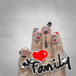 Happy finger couple in love with painted smiley on crumpled pape — Stock Photo