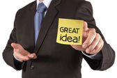 Businessman hand show great idea words on sticky note with white — Stock Photo