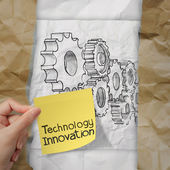 Hand holding innovation on sticky note with gear to success — Stock Photo