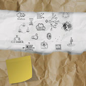 Hand drawn business strategy icons on crumpled paper with tear — Stock Photo