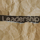 Hand drawn leadership words on crumpled paper with tear envelop — Stock Photo
