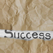 Hand drawn success words on crumpled paper with tear envelope as — Stock Photo