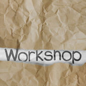 Hand drawn workshop words on crumpled paper with tear envelope a — Stock Photo