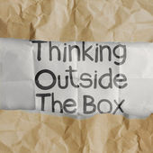 Hand draws thinking outside te box on crumpled paper — Stock Photo