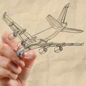 Hand drawing airplane with crumpled paper background — ストック写真