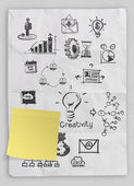 Business concept on crumpled paper and sticky note background — Stock Photo