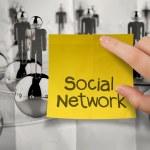 Постер, плакат: Hand holding sticky note social network