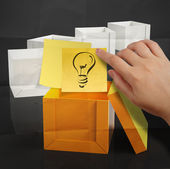 Hand holding sticky note with thinking outside the box on dark c — Stock Photo