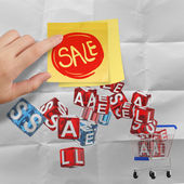 Sticky note with sale word and 3d shopping cart sale on crumpled — Stok fotoğraf