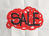 Word sale with crumpled paper background — Stockfoto