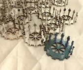 Model of 3d figures on connected cogs — Stock Photo