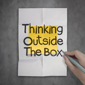 Thinking outside the box on crumpled sticky note paper as concep — Stock Photo