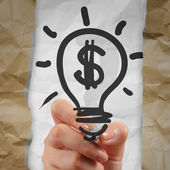 Hand drawing light bulb dollar sign with crumpled paper as creat — Stock Photo