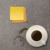 Cup of coffee and blank sticky note on stone top as concept — Stock Photo