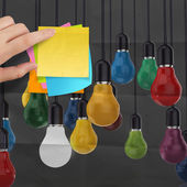 Sticky note with light bulb on crumpled paper as creative conc — Stock Photo