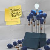 Thinking outside the box on sticky note and pencil lightbilb — Stock Photo