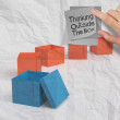 Thinking outside the box on crumpled sticky note paper — Stock Photo