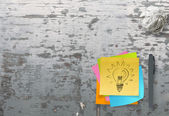 Lightbulb as creative on crumpled sticky note paper — Stock Photo