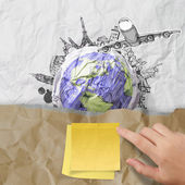 Sticky note on recycle envelope with crumpled paper and travelin — Stock Photo
