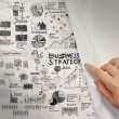 Hand drawn business strategy on crumpled paper background — Stock Photo