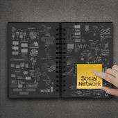 Hand push sticky note socual network on book of success busines — Stock Photo