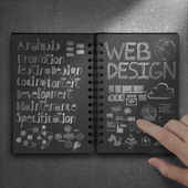 Hand touch book of hand drawn web design diagram background as — Stock Photo