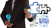 Businessman hand drawing Partnership Puzzle Concept — Stock Photo