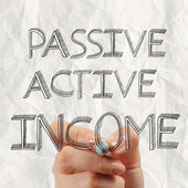 Close up of hand drawing passive or acctive income as concept — Stock Photo