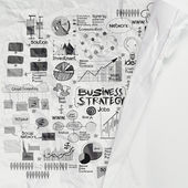 Hand drawn business strategy on crumpled paper as concept — Stock Photo